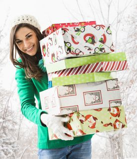 Photo of a woman with presents, illustrating About.com's Holiday Sweepstakes List.