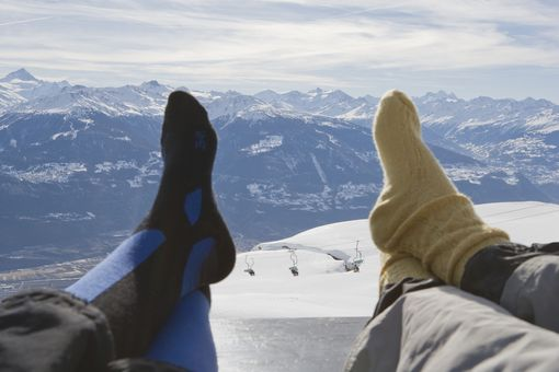 Resting feet on a mountaintop