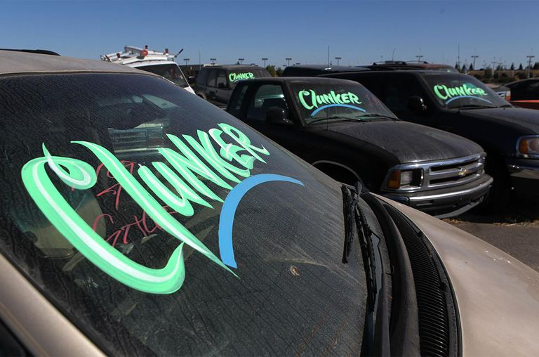 Cars traded in for the Cash For Clunkers program sit in a storage lot August 26, 2009 in Fairfield, California.