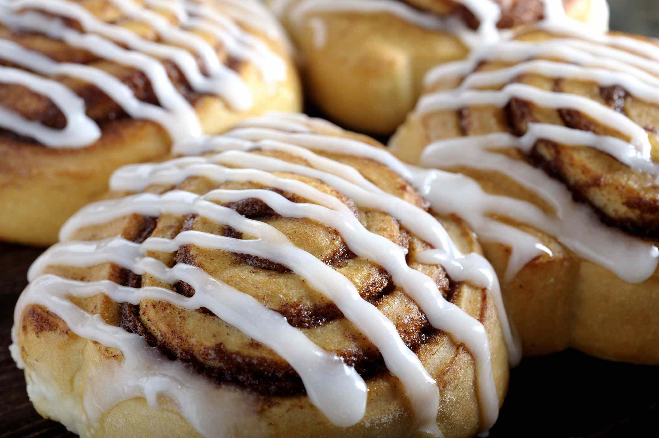 A close-up photo of cinnamon rolls with icing