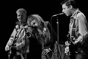 Exene Cervenka (center), lead singer of the quintessential Los Angeles punk rock band 'X' performs at a 1982 Reseda, California concert.