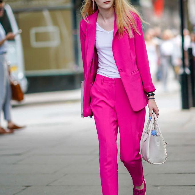 Street style woman in pink pantsuit