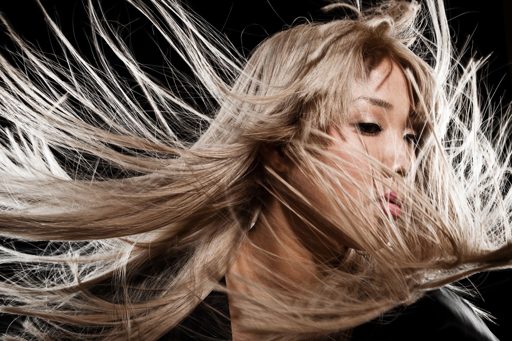 Woman shaking head with blonde hair