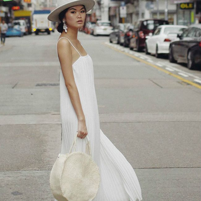 Street Style Woman in White Maxi Dress