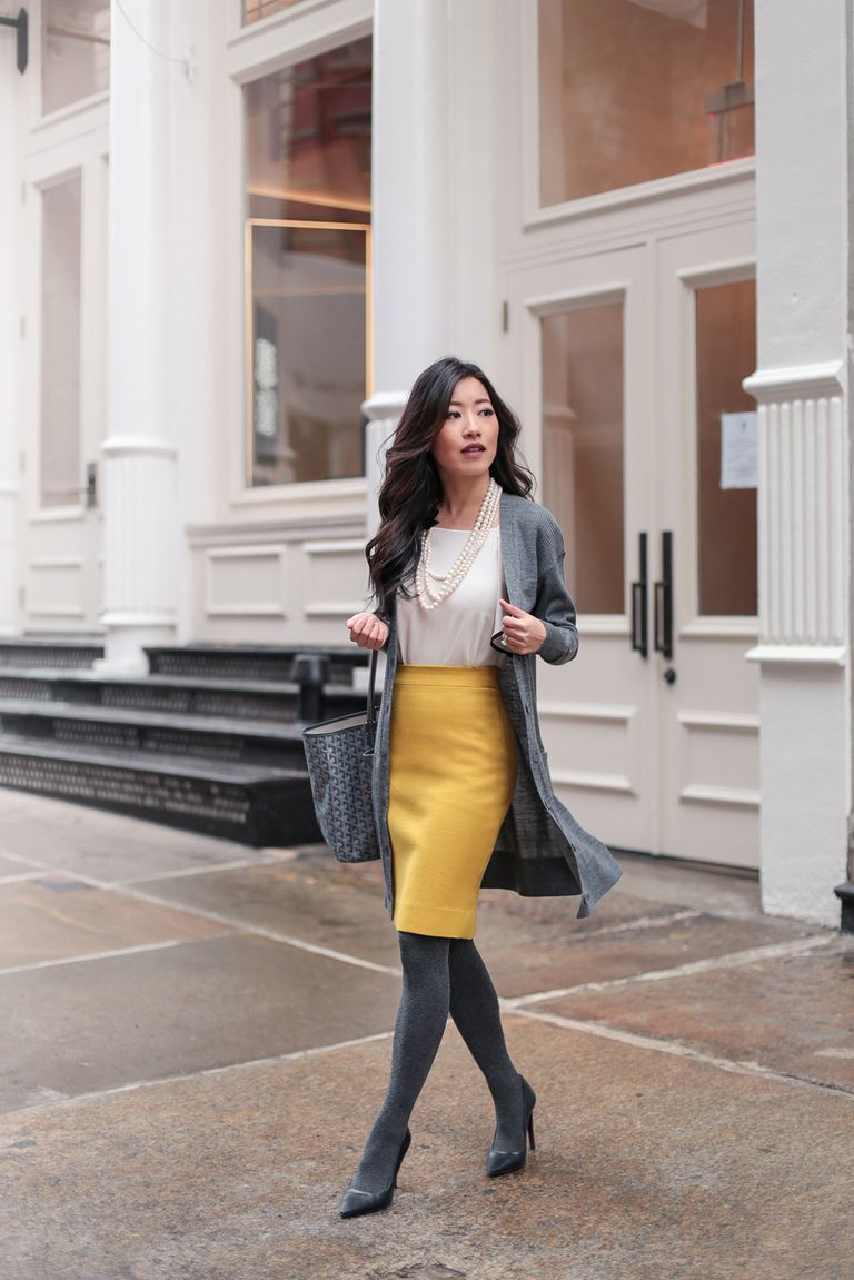 b0d824cad5ef Woman in yellow skirt and white blouse and grey sweater for work