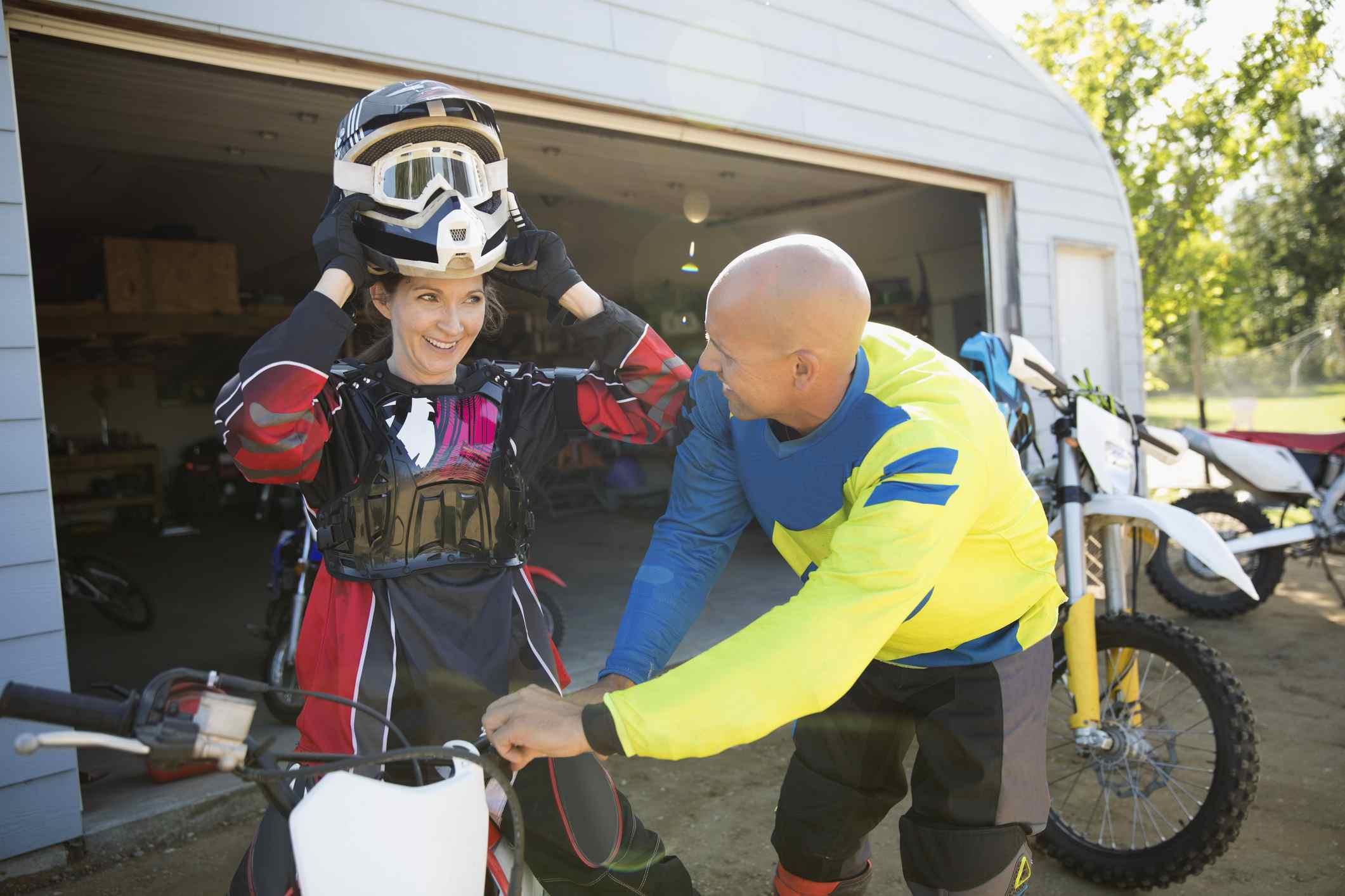 Woman putting on dirtbike gear
