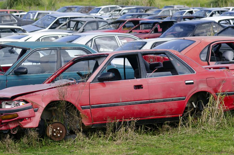 Salvage yard full of wrecked cars