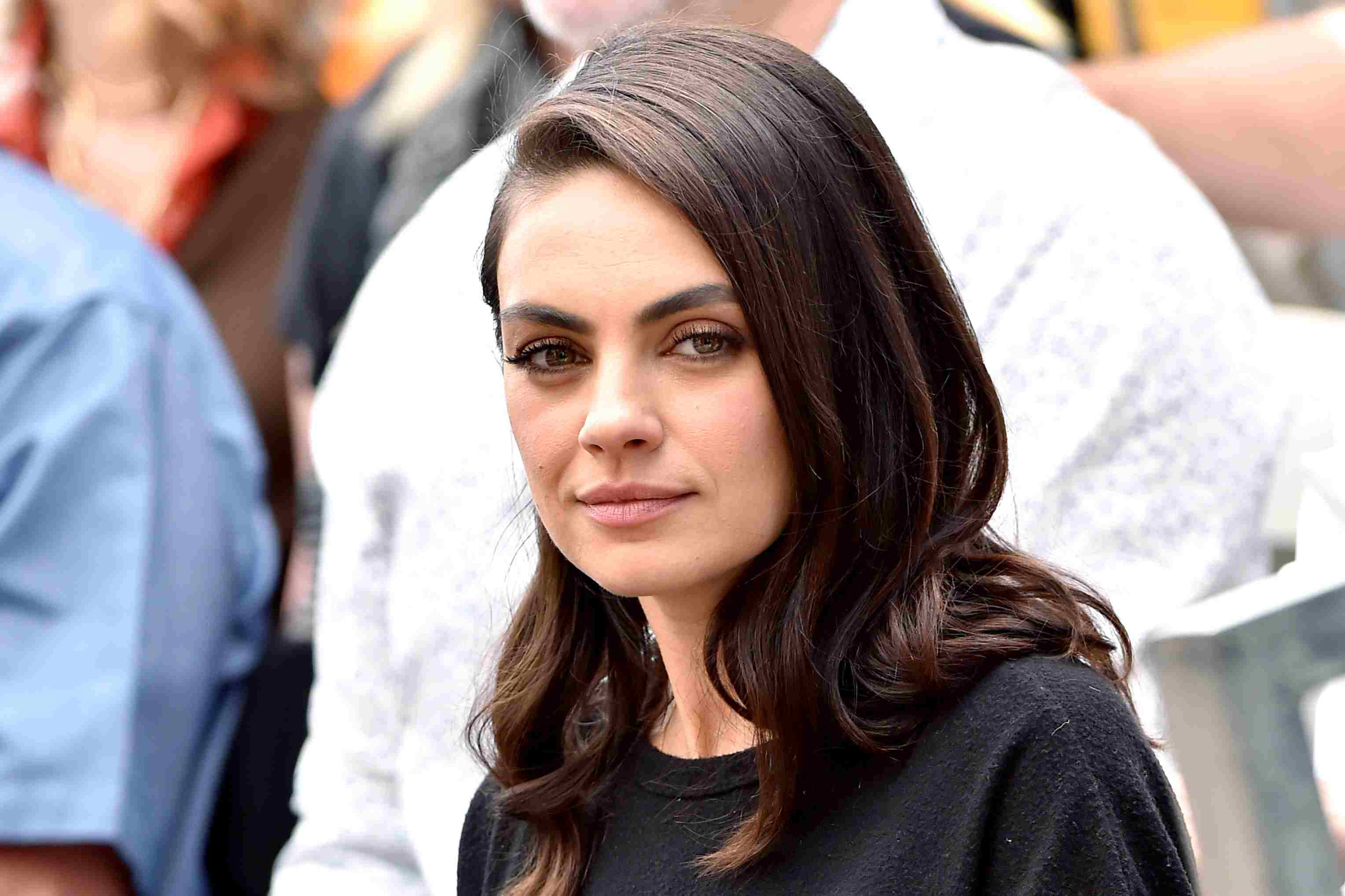 Mila Kunis in the audience as MacFarlane is honored with a star on the Hollywood Walk of Fame
