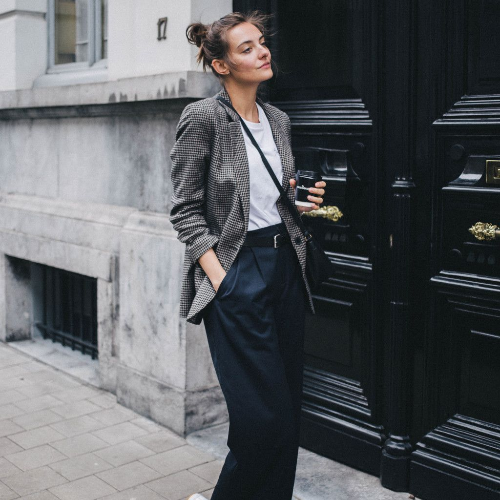 Woman in trousers and blazer menswear inspired style