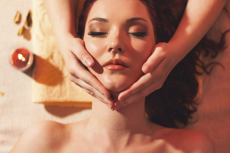 Beauty portrait of a woman receiving a massage