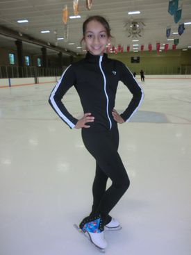 A Figure Skater Wears Skating Pants and Jacket From Skating Designs