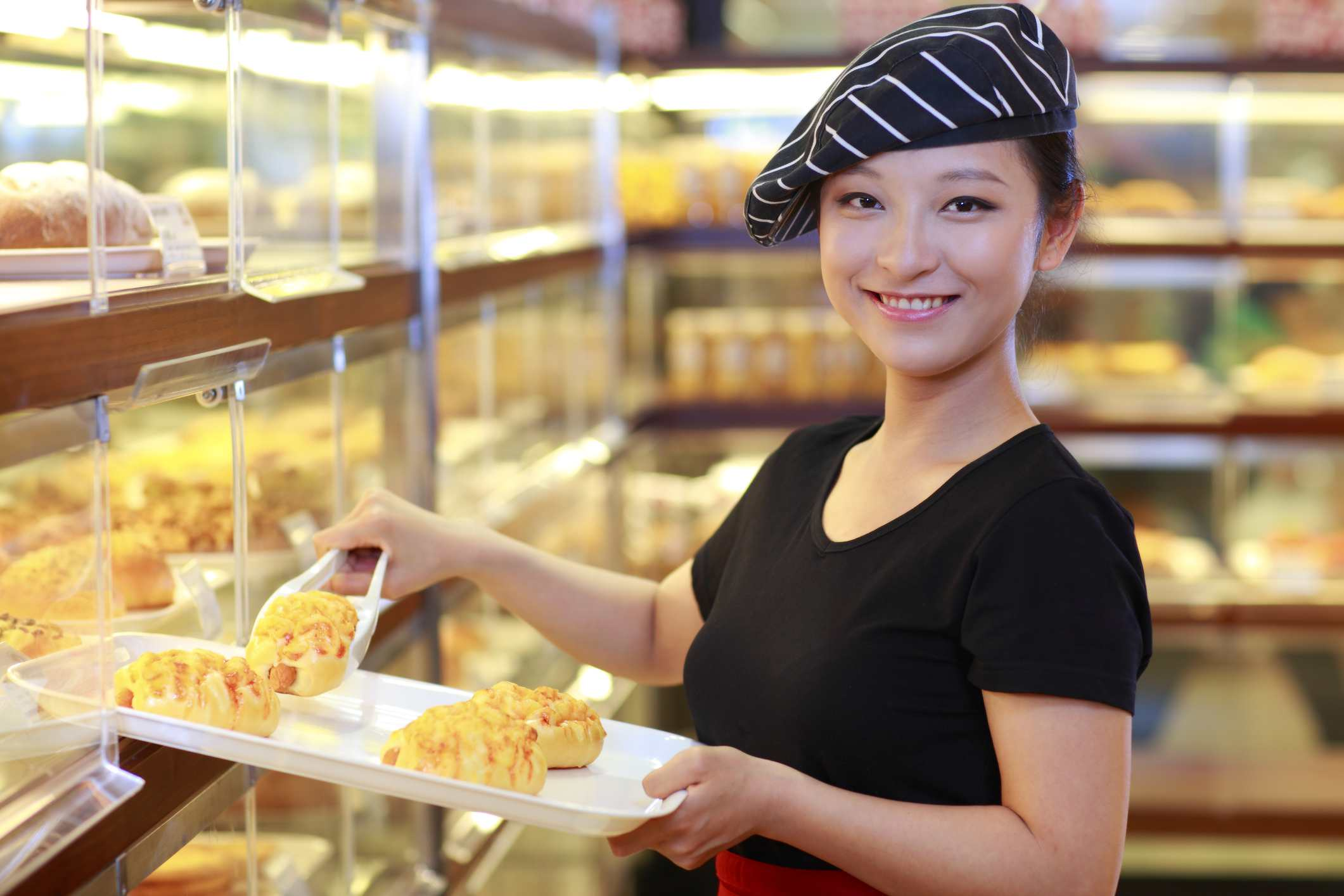 pretty young woman working in the bakery