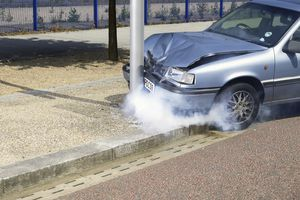 Car crash against pole by road