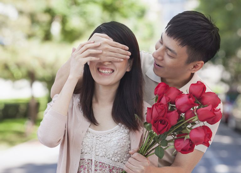 Chinese man surprising girlfriend with roses.