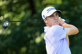 Justin Thomas plays his shot from the 16th tee during round one of The Northern Trust tournament in 2017