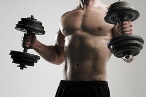 Man holding weights during workout