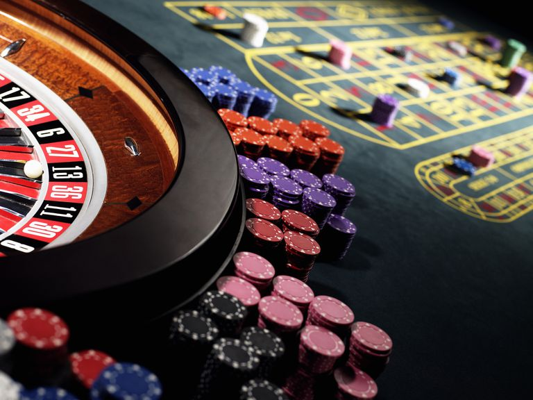 Image of a Roulette Wheel and Chips