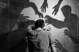Shadow people attacking a man