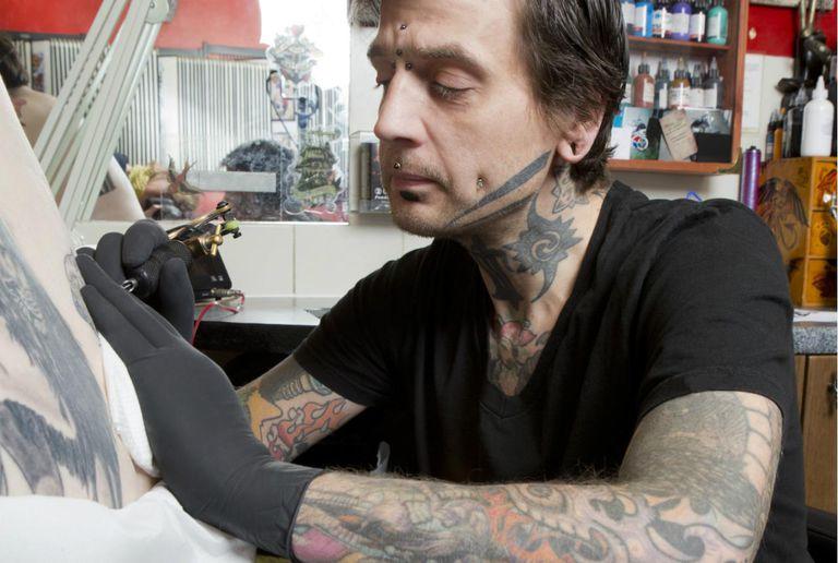 Tattoo artist doing a tattoo