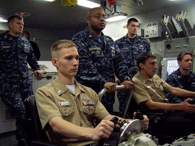 Sailors assigned to the guided-missile submarine USS Florida (SSGN 728) practice skills controlling the boat.