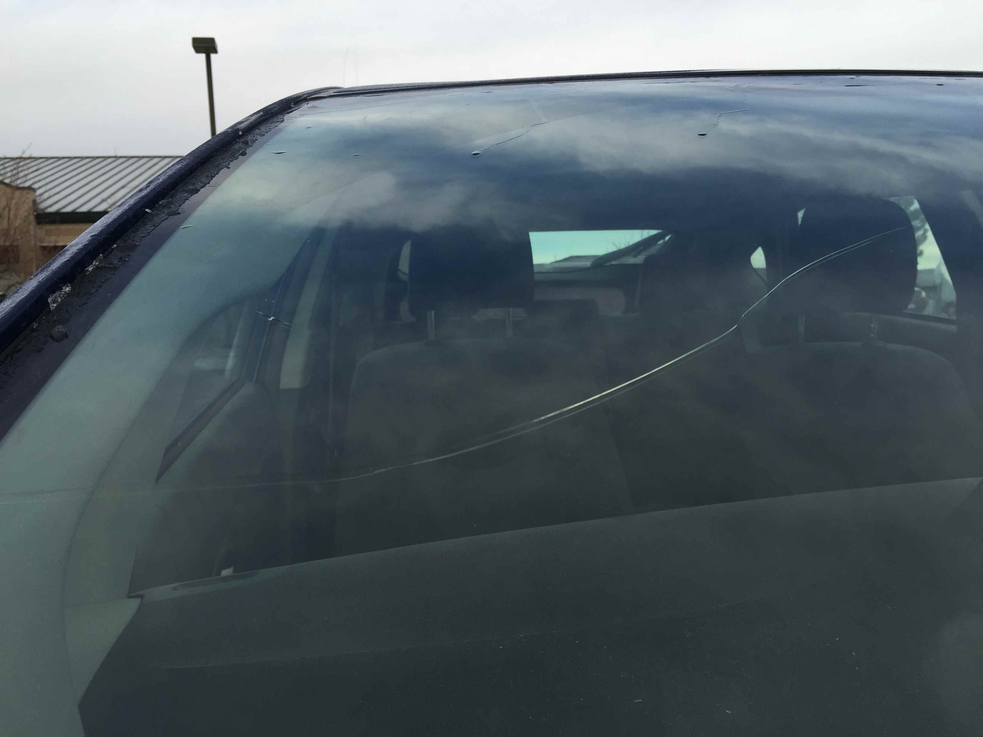 A long windshield crack.