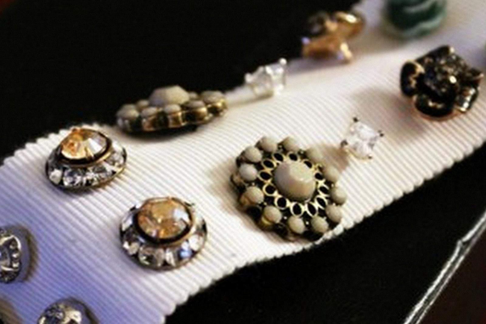 Earrings stored on ribbon