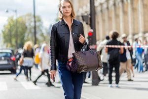 Street woman in jeans going to work