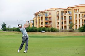 Golfer Scott Jamieson strikes the ball during the Portugal Masters golf tournament