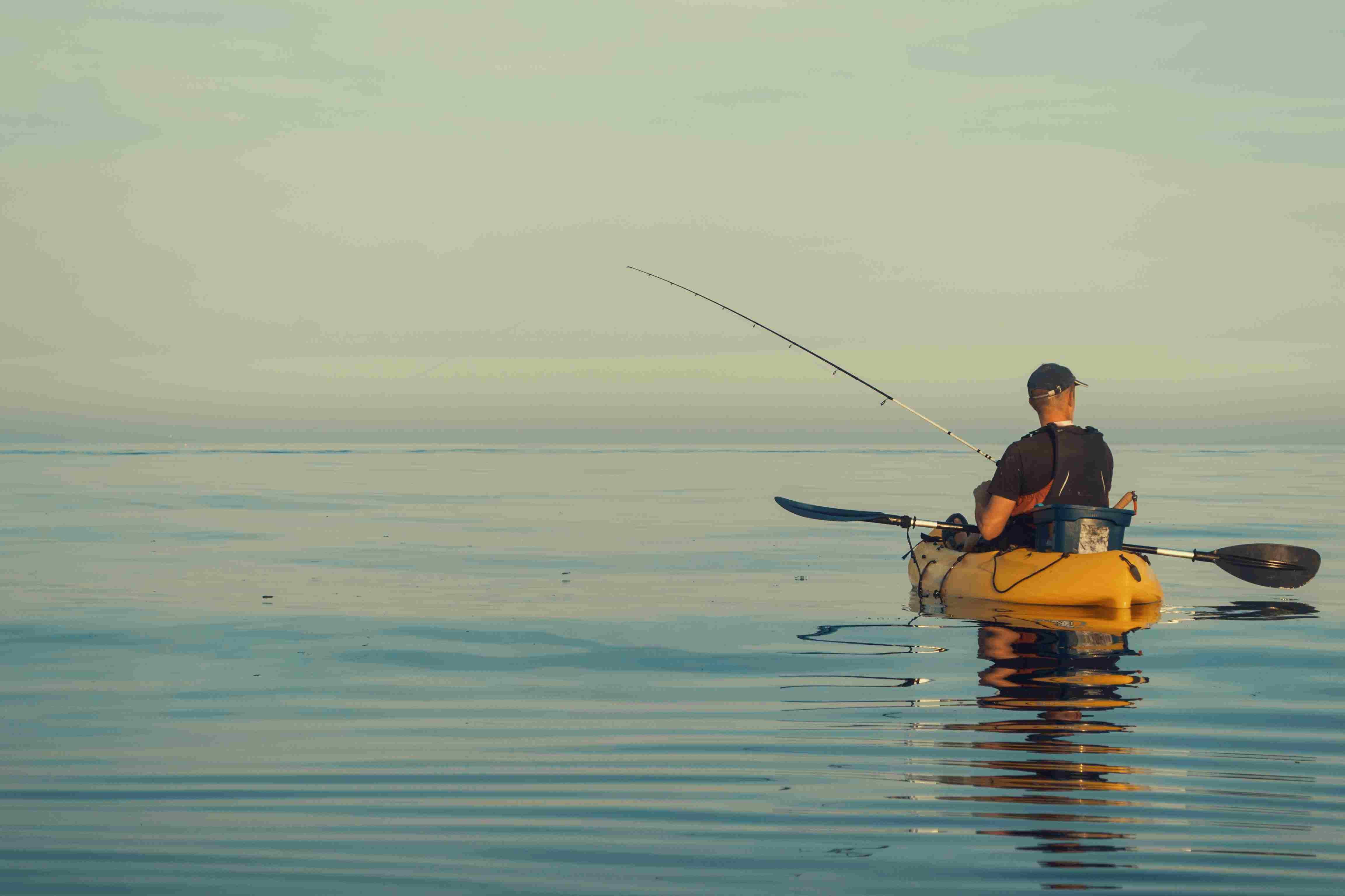 Kayak fishing on calm and sunny seas