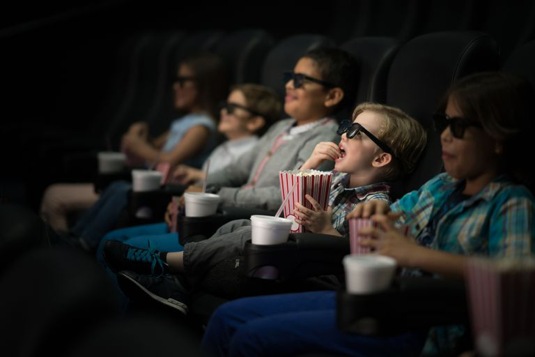 Children in 3D glasses watching a movie in a theater