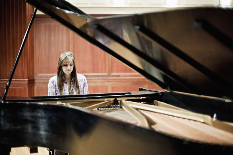 A female pianist playing piano
