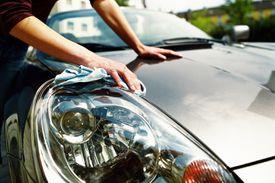 woman polishing headlight