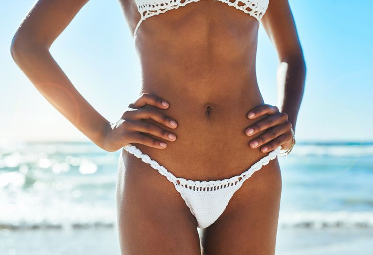 Tan woman in a white crochet bikini