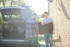 Male gay couple moving furniture