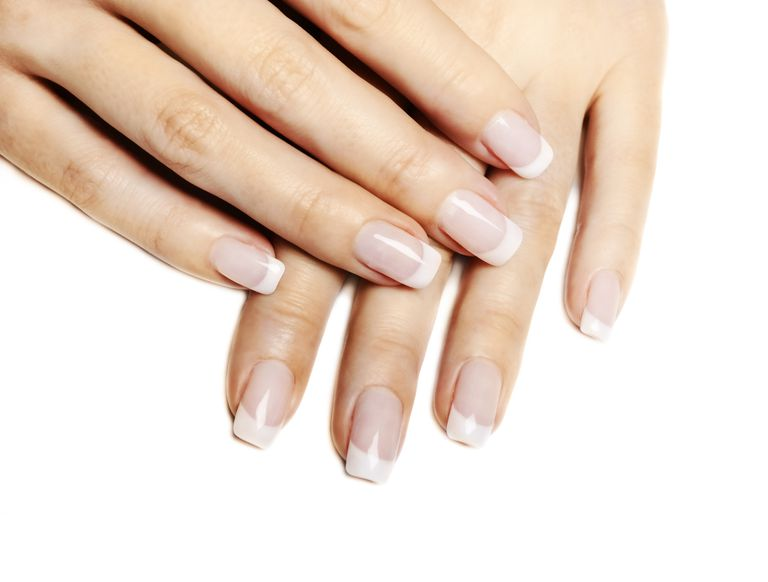 Two hands with a french manicure