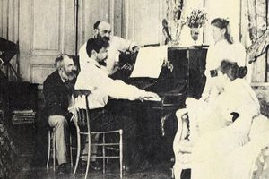 Debussy playing the piano