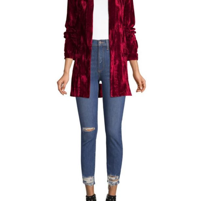 Woman in red velvet blazer and jeans