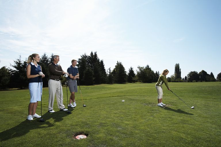 A team of four golfers on the tee