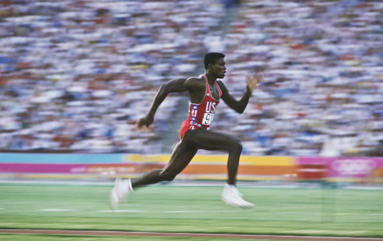 Carl Lewis of the USA accelerates down the runway of the long jump during the 1984 Summer Olympics
