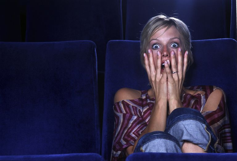 Woman watching a horror movie