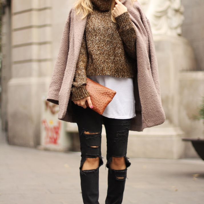 f89f8be00d3a Woman wearing sweater and ripped black jeans and winter coat