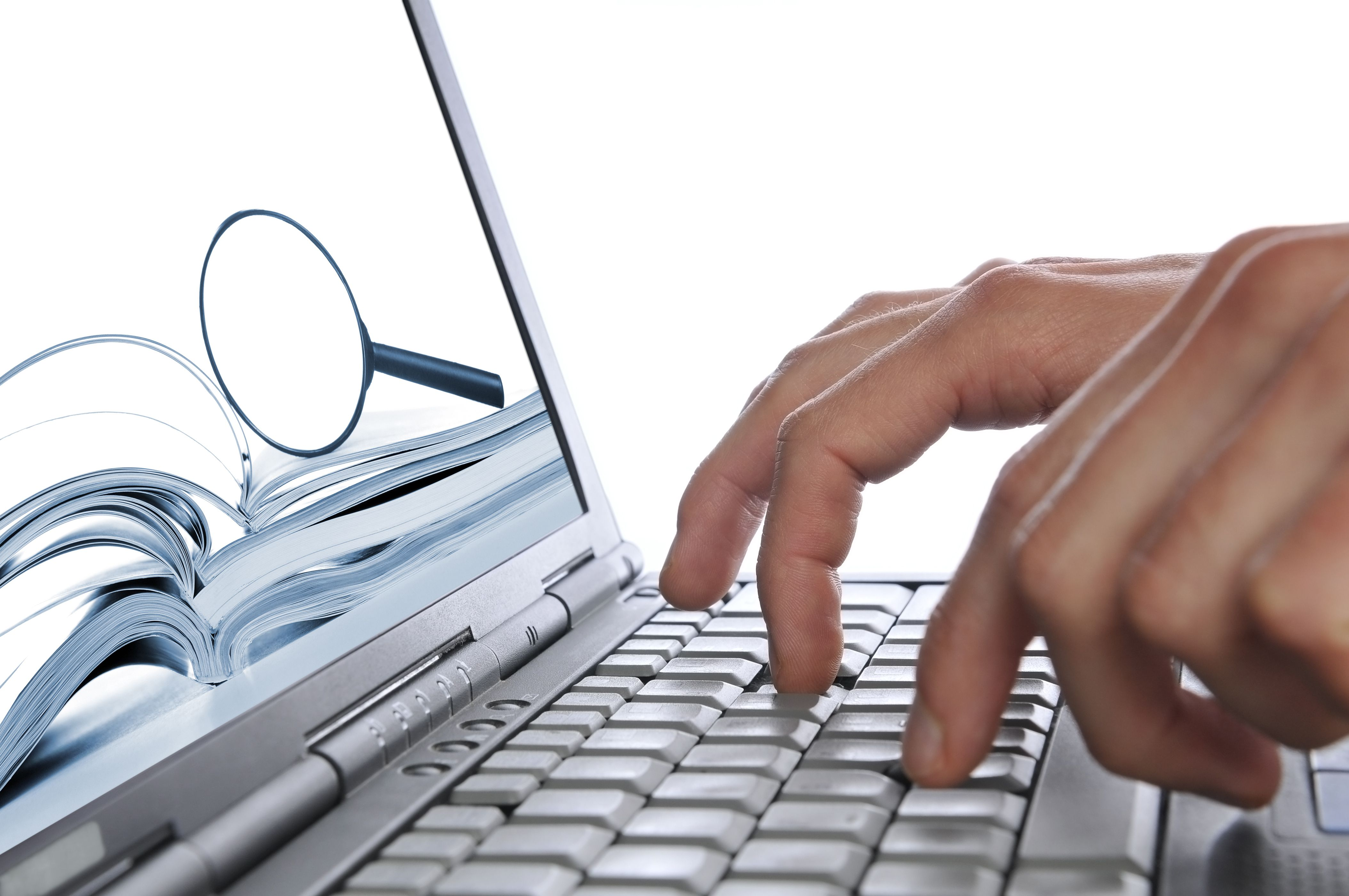 Searching internet, man's hands laptop keyboard, magnifying glass on screen