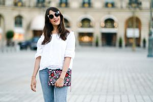 Street style woman in jeans and white blouse
