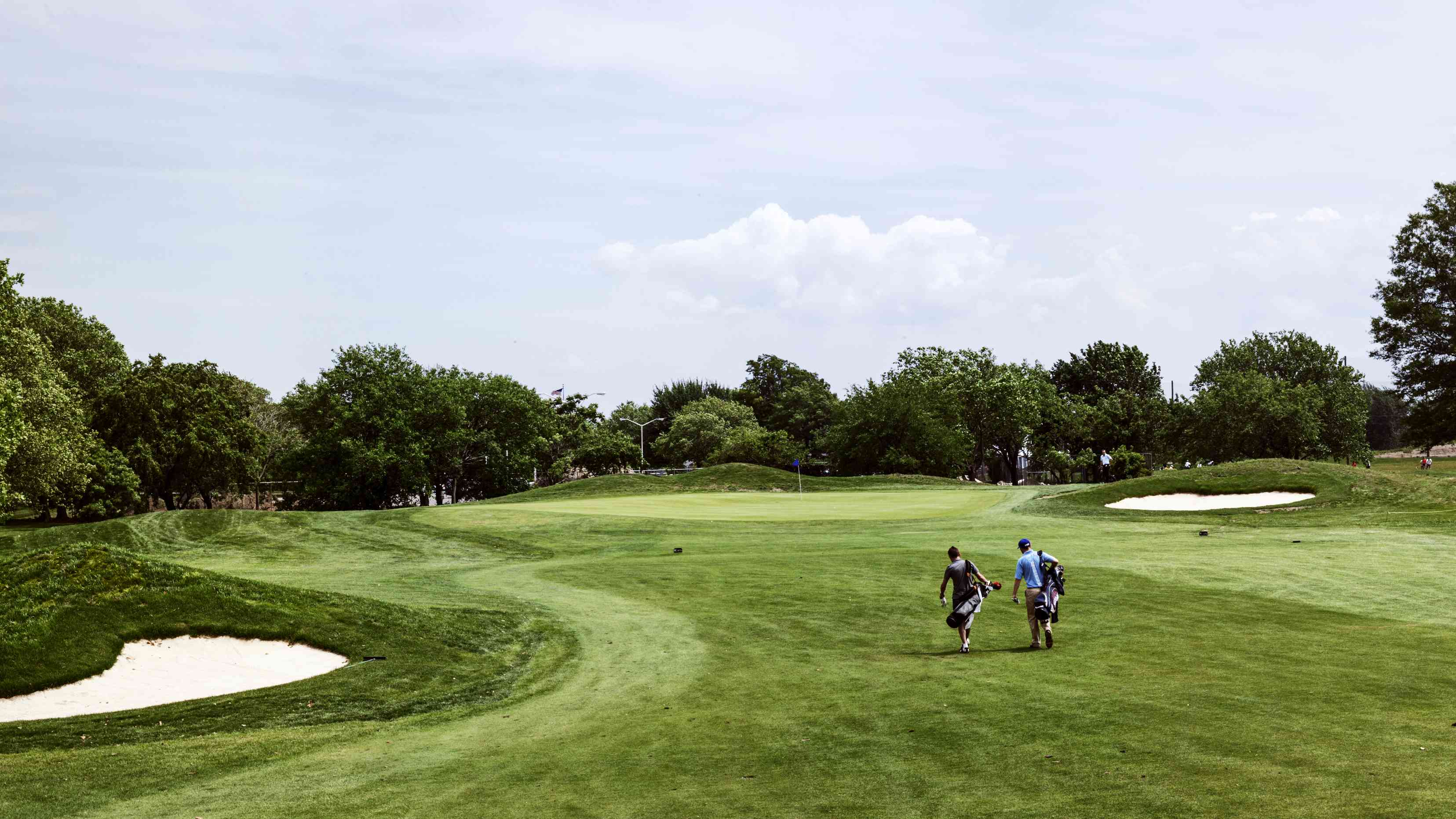 Golfers approach the 14th green at Marine Park Golf Course.