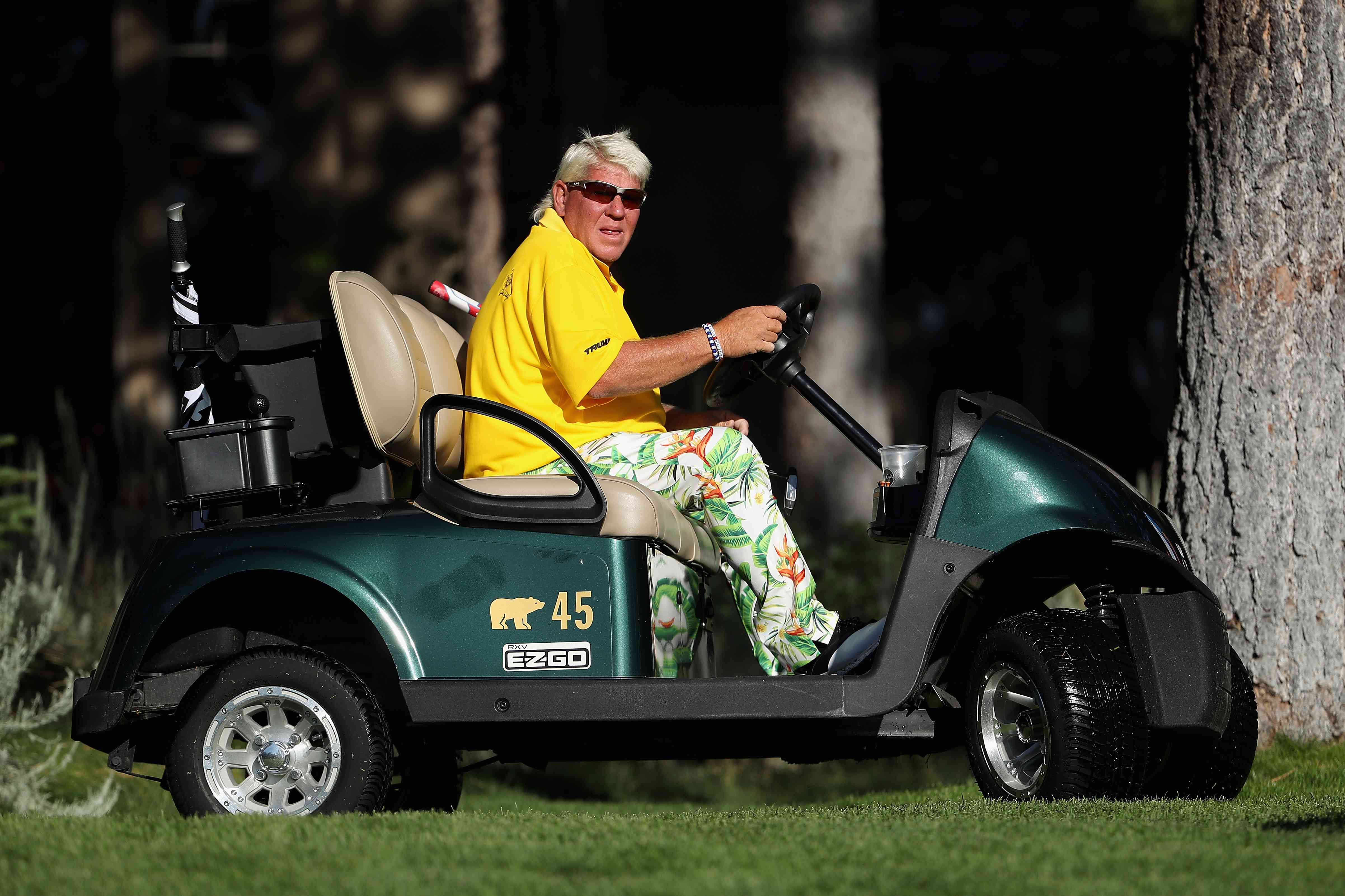 John Daly drives a cart up to the 16th tee during the continuation second round of the Barracuda Championship at Montreux Country Club on July 27, 2019 in Reno, Nevada.