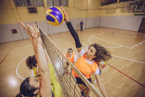 Ladies playing volleyball