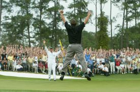 Phil Mickelson leaps into the air after making the winning putt at the 2004 Masters