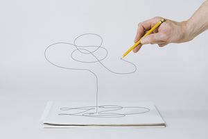 Hand drawing curvy lines with a pencil