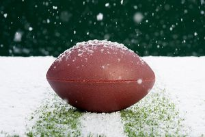 football on field in snow
