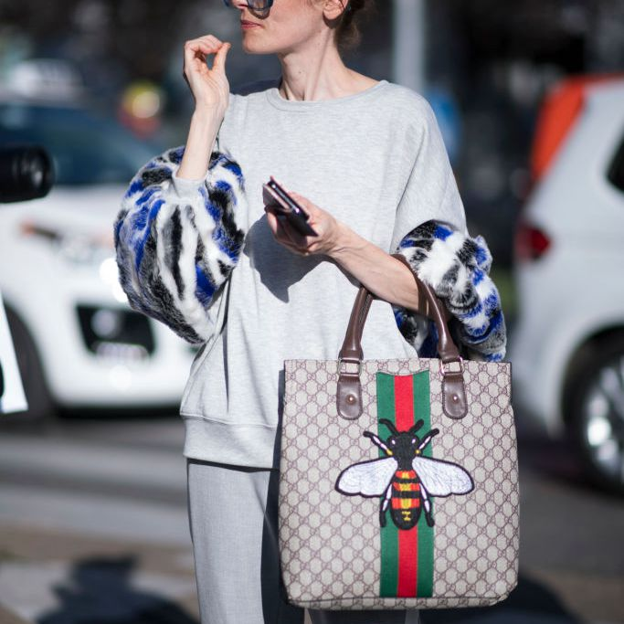 Street style woman in sweatsuit and Gucci purse